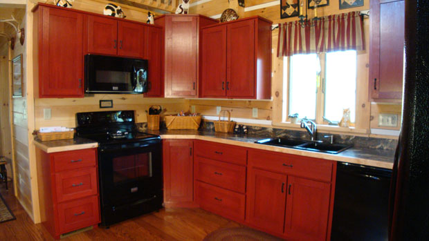 hand crafted solid cherry stained cabin red kitchen